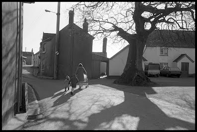 James Ravilious:  Village square, Burrington, February 1987